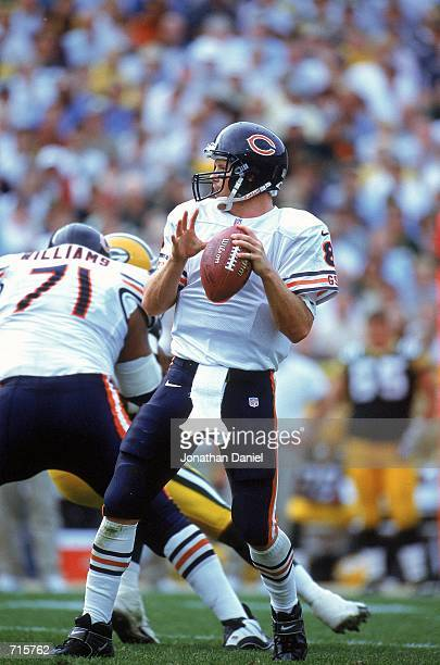 Quarterback Cade McNown of the Chicago Bears moves pass the ball during the game against the Green Bay Packers at Lambeau Field in Green Bay...