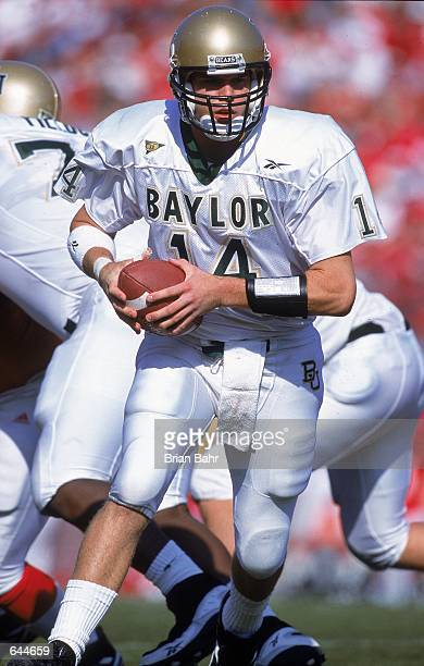Quarterback Guy Tomchek of the Baylor Bears scrambles with the ball during the game against the Nebraska Cornhuskers at the Memorial Stadium in...