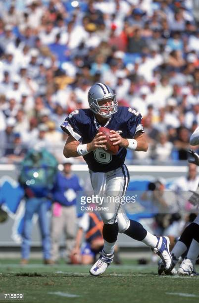 Quarterback Troy Aikman of the Dallas Cowboys moves back to pass the ball during the game against the Carolina Panthers at the Ericsson Stadium in...