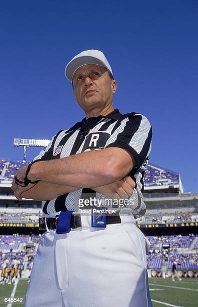 Referee Bernie Kukar stands on the field before the game between the Pittsburgh Steelers and the Baltimore Ravens at the PSINet Stadium in Baltimore...