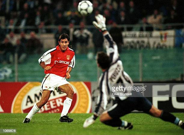Robert Pires of Arsenal scores the eqaulizer in the last minute during the match between Lazio and Arsenal in the UEFA Champions League Group B at...