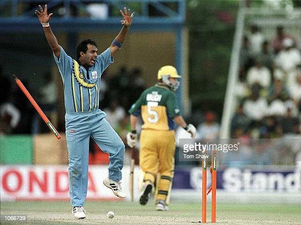 Robin Singh of India celebrates as a direct hit runs out Shane Lee of Australia during the Australia v India second round match of the ICC Knockout...