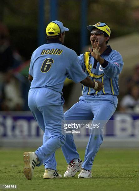 Robin Singh of India is congratulate by after taking the wicket of Ricky Ponting of Australia during the Australia v India second round match of the...