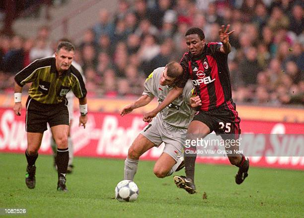 Roque Junior of AC Milan battles with Zinedine Zidane of Juventus during the Italian Serie A game played at the San Siro Stadium in Milan Italy The...