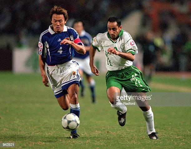Ryuzo Morioka of Japan chases down Sami Al Jaber of Saudi Arabia during the Asian Cup Final match at Sports City in Lebanon Japan won 10 Mandatory...