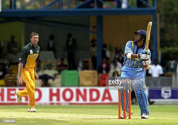 Sachin Tendulkar of India hits a six off the bowling of Glen McGrath of Australia during the ICC Knockout Tournament second round match between India...