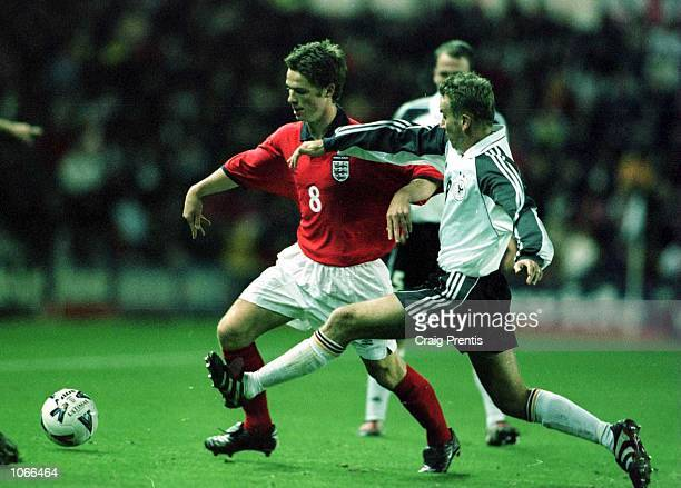 Scott Parker of England holds off Christian Timm of Germany during the match between England U21 and Germany U21 at Pride Park, Derby. Mandatory...