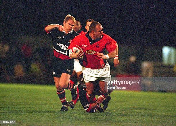 Scott Quinnell of Llanelli is tackled during the Heineken Cup Pool Match against Gloucester at Stradey Park in Llanelli Wales Mandatory Credit Dave...