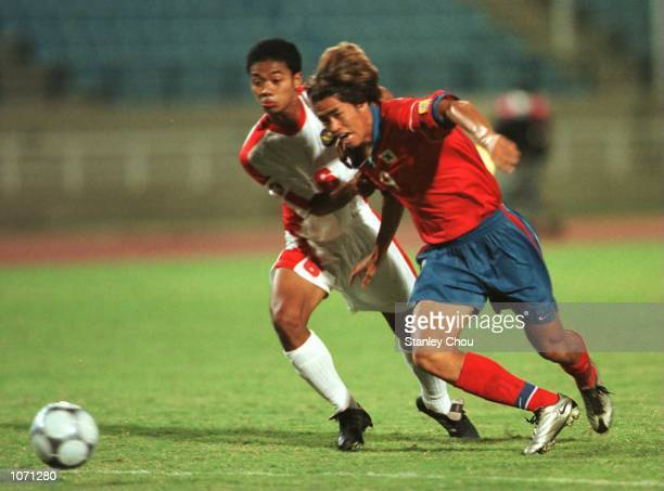 Seol KiHyeon of Korea is checked by Eko Purdjianto of Indonesia in yesterday's South Korea 30 win at Sports City Stadium Beirut Mandatory Credit...