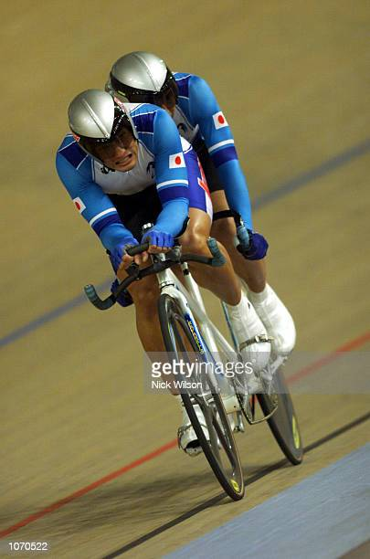 Shigeo Yoshihara and Koichi Mizusawa of Japan in action during the Mens Tandem Individual Pursuit Open cycling during the Sydney 2000 Paralympics at...