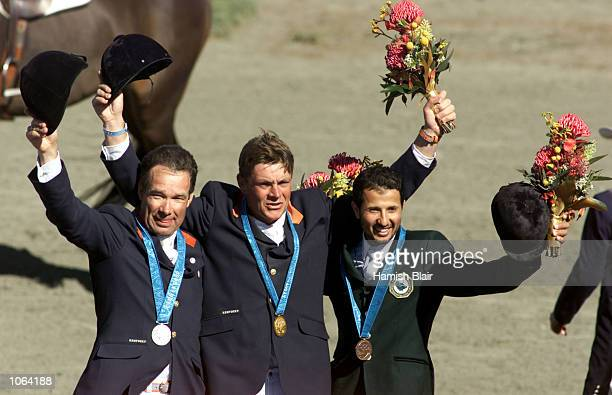 Silver medalist Albert Voorn of the Netherlands gold Medalist Jeroen Dubbeldam of the Netherlands and bronze medalist Khaled Al Eld of Saudia Ardia...