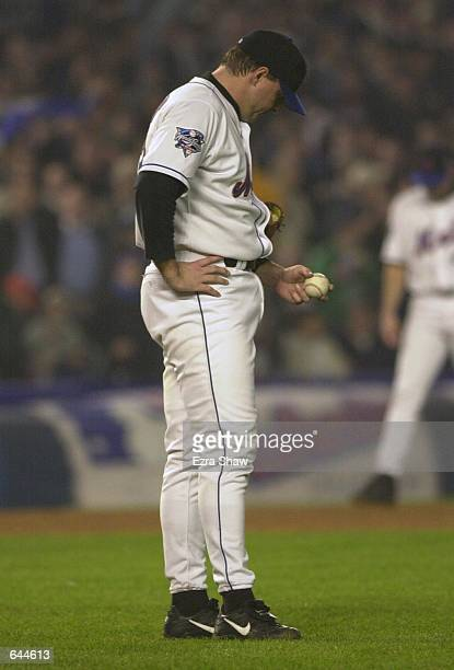 Starting pitcher Al Leiter of the New York Mets walks back to the mound after giving up a home run to Derek Jeter of the New York Yankees in the...