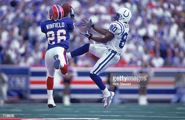 Terrence Wilkins of the Buffalo Bills misses the pass as Antoine Winfield of the Indianapolis Colts intercepts the ballat the Ralph Wilson Stadium in...