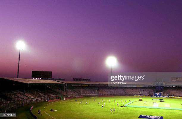 The England players train under the lights during the England nets session at the National Stadium, Karachi, Pakistan . Mandatory Credit: Tom...