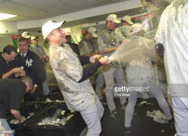 The New York Yankees celebrate in the locker room their 42 win and World Series Championship over the New York Mets after Game 5 of the World Series...