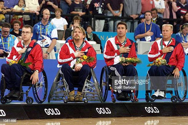 The USA celebrate their gold medal at the Mens Wheelchair Rugby Gold Medal Ceremony during the Sydney 2000 Paralympic Games at the Dome Homebush Bay...