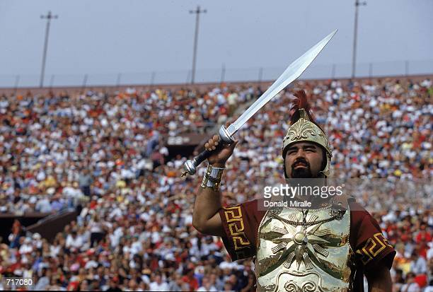 The USC Trojans mascot cheers from the sidelines durnig a game against the Arizona Wildcats at the Coliseum in Los Angeles California The Wildcats...