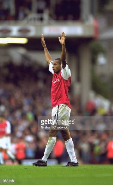 Thierry Henry of Arsenal celebrates scoring the winning goal during the FA Carling Premiership match against Manchester United played at Highbury in...