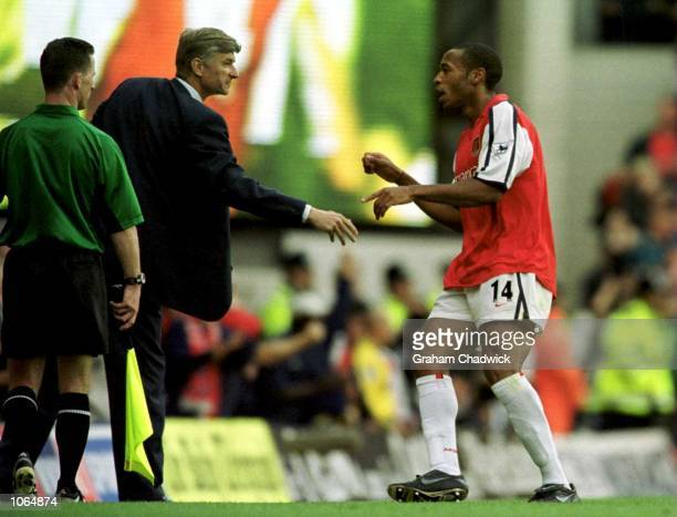 Thierry Henry of Arsenal celebrates with manager Arsene Wenger after scoring during the FA Carling Premiership game between Arsenal and Manchester...
