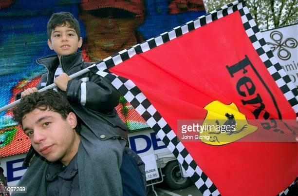 Tifosi celebrate Ferrari driver Michael Schumacher's win in the Formula One Japanese Grand Prix to clinch the World Drivers Championship, Ferrari's...