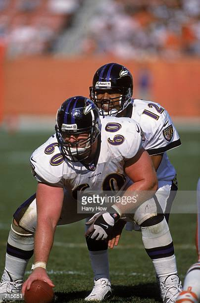 Tony Banks of the Baltimore Ravens calls the play behind Center Jeff Mitchell during the game against the Cleveland Browns at the Browns Stadium in...