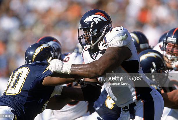 Tony Jones of the Denver Broncos pushes Adrian Dingle of the San Diego Chargers at the Qualcomm Stadium in San Diego, California. The Broncos...