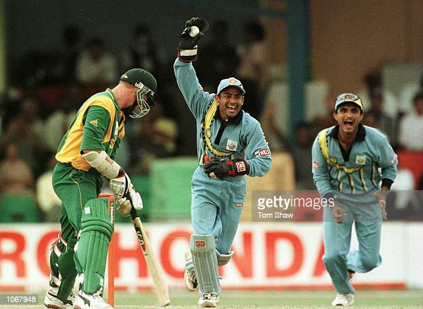 V Dahir and Sourav Ganguly of India celebrate the catching of Lance Klusener of South Africa during the India v South Africa SemiFinal of the ICC...