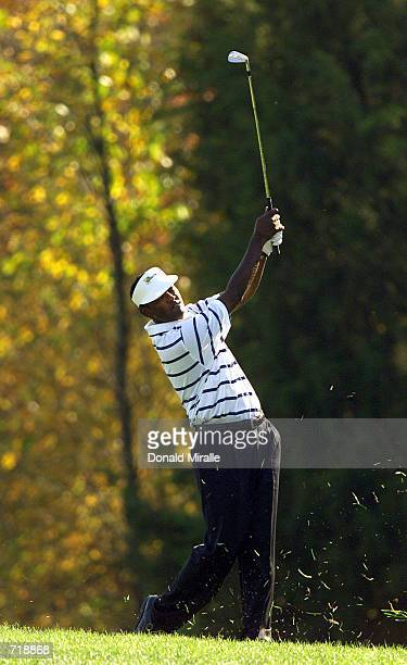 Vijay Singh of the International Team hits out from the fairway during his match against Tiger Woods and Notay Begay of the USA in the first round of...