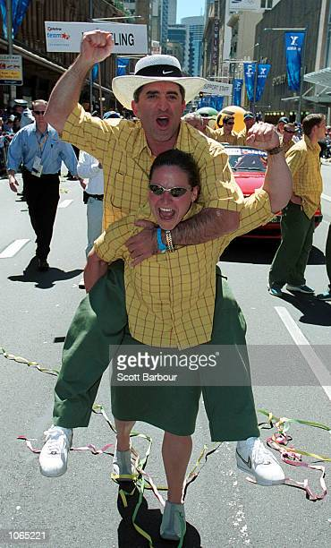 Weightlifter Michelle Kettner celebrates with a team mate during the ticker tape parade to honour Australia's Olympic Athletes in Sydney Australia...