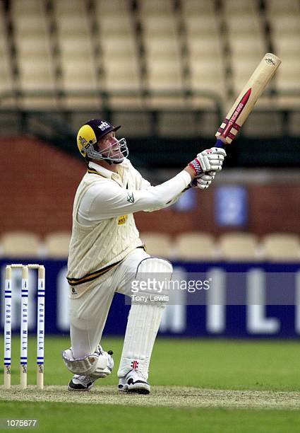 Western Australian batsman Tom Moody sends South Australia's Peter McIntyre to the boundary in the Pura Milk Cup Cricket match between the Western...