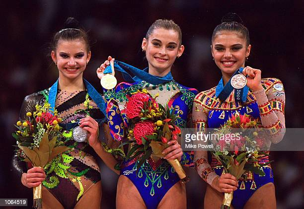 Yulia Barsakova of Russia wins Gold, Yulia Raskina of Belarus wins Silver and Alina Kabaeva of Russia wins Bronze in the Womens Rhythmic Gymnastics...
