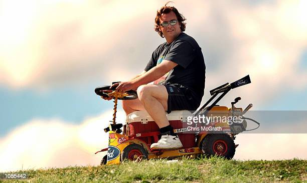 A motorsport fan watches the action from his esky rideon mower during qualifying for the Bathurst 1000 V8 Supercar race held at Mt Panorama Bathurst...