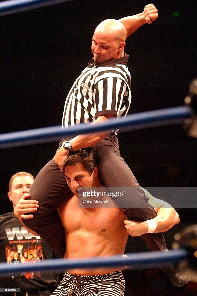 A referee gets involved during the WWA Wrestling 'Inception' fight night held at the Sydney Superdome, Sydney, Australia. DIGITAL IMAGE Mandatory Credit: Chris McGrath/ALLSPORT