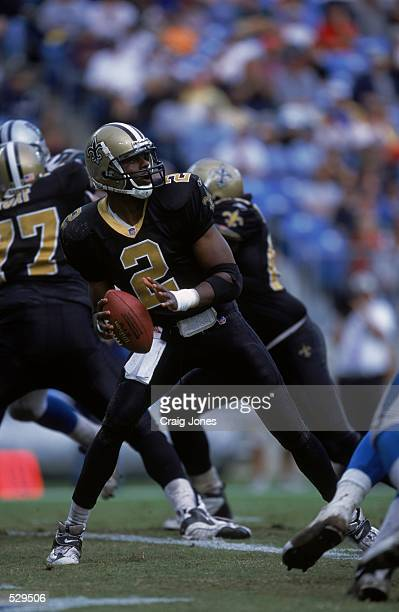 Aaron Brooks of the New Orleans Saints pulls back to throw the ball during the game against the Carolina Panthers at Ericsson Stadium in Charlotte...