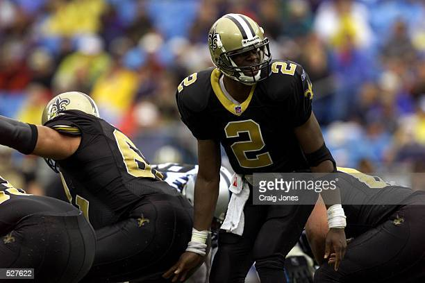 Aaron Brooks of the New Orleans Saints signals to his team against the Carolina Panthers during the game at Ericsson Stadium in Charlotte North...