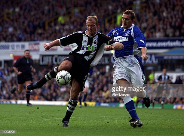 Alan Shearer of Newcastle holds off a challenge from Alan Stubbs of Everton during the Barclaycard Premier League match between Everton and Newcastle...
