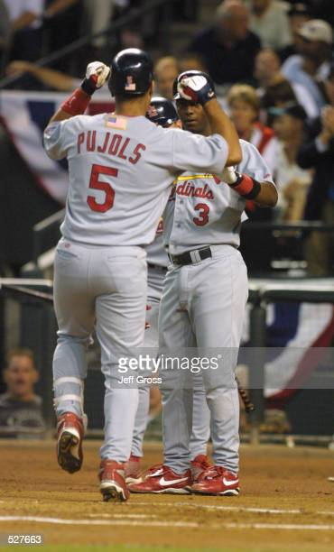 Albert Pujols of the St Louis Cardinals celebrates after hitting a home run against Randy Johnson of the Arizona Diamondbacks during Game 2 of the...