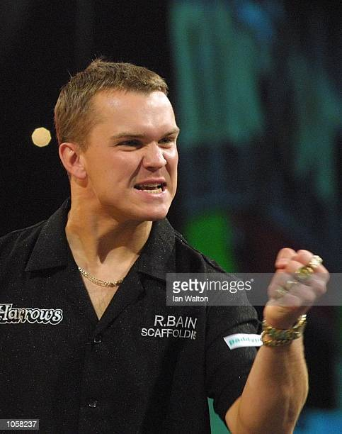 Alex Roy of England celebrates winning his first round game against Steve Brown of USA during the Professional Darts Corporation and Paddy Power...