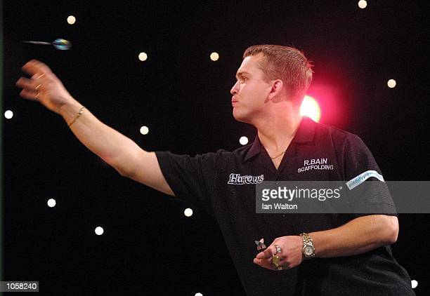 Alex Roy of England in action against Steve Brown of USA during the first round game in the Professional Darts Corporation and Paddy Power World...
