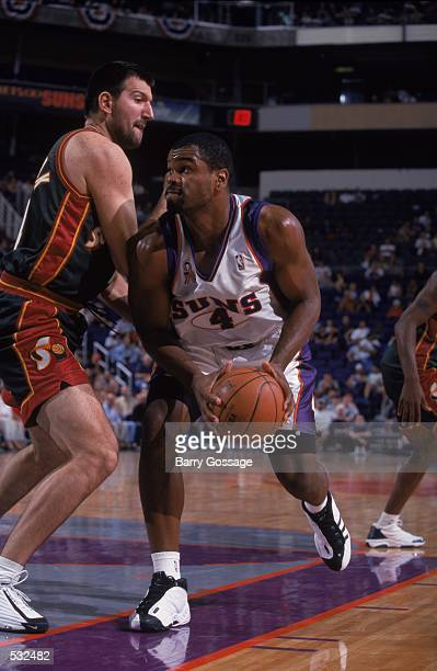 Alton Ford of the Phoenix Suns moves to take a shot against Predrag Dronjak of the Seattle SuperSonics during the preseason game at the America West...