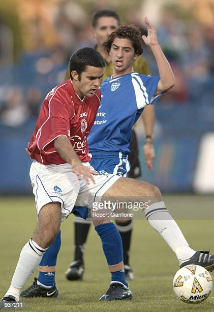 Ante Deur of Sydney United is challenged by Marco Santilli of South Melbourne during the round 3 NSL match between South melbourne and Sydney United...