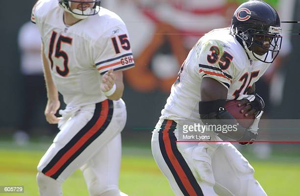 Anthony Thomas the Chicago Bears takes the handoff from quarterback Jim Miller during the game against the Cincinnati Bengals at Paul Brown Stadium...
