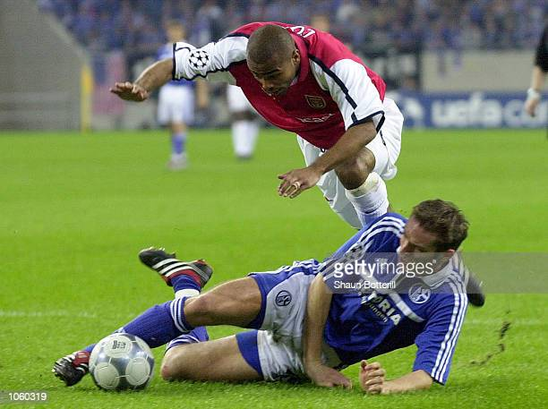 Ashley Cole of Arsenal dives over the top of the Sven Vermant of Scalke during the UEFA Champions League First Stage Group C match between FC Schalke...