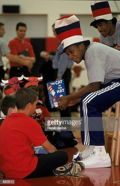 B J Armstrong of the Chicago Bulls reads to children in the Read to Achieve childrens reading program at the Sheri Berto Center in Deerfield Illinois...