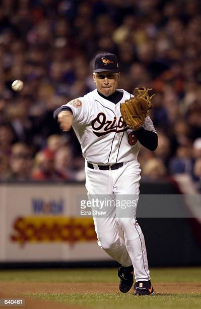 Cal Ripken Jr #8 of the Baltimore Orioles throws to first for a putout in the final game of his career at Camden Yards in Baltimore Maryland The Red...