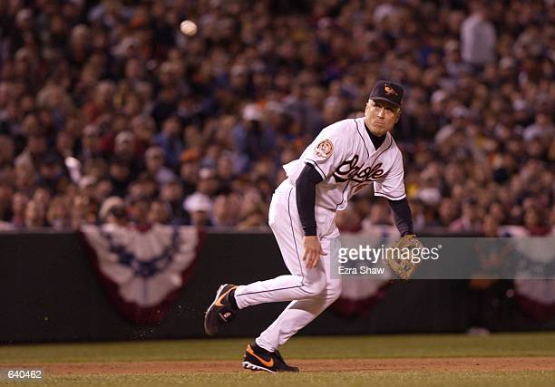 Cal Ripken Jr. #8 of the Baltimore Orioles tries to make a play on the ball in the last game of his career at Camden Yards in Baltimore, Maryland....