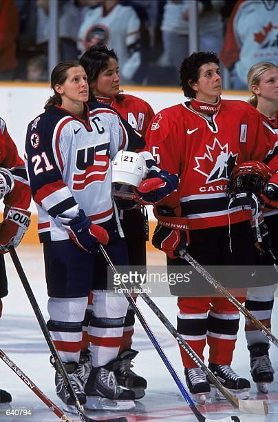 Cammi Granato of the USA stands next to Danielle Goyette of Canada before the game at the Compaq Center in San Jose California The USA defeated...
