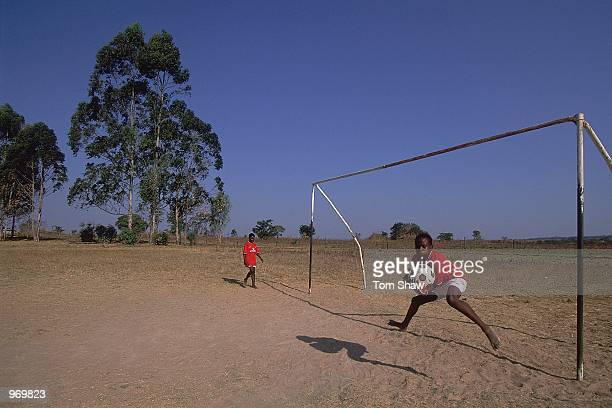 Children playing football at the Andy Cole Childrens Foundation Orphanage at Melford in Zimbabwe Mandatory Credit Tom Shaw /Allsport