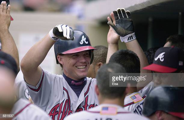 Chipper Jones of the Atlanta Braves celebrates his 3-run home run in the eighth inning against the Houston Astros during game one of the National...