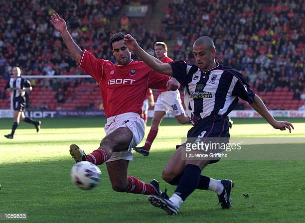 Chris Barker of Barnsley fails to stop a cross from Neil Clement of West brom during the Nationwide First Division game between Barnsley and West...